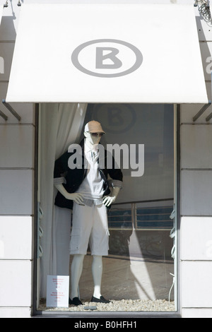 Male mannequin in the shop window of the Bogner fashion boutique on the Residenzstrasse, Munich, Bavaria, Germany - Stock Photo