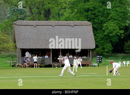 Village cricket at Stanway, Gloucestershire, England, UK - Stock Photo