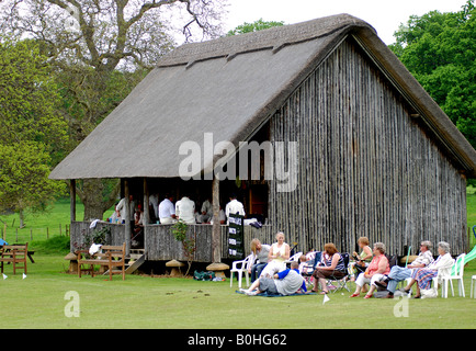 Thatched cricket pavilion at Stanway, Gloucestershire, England, UK - Stock Photo