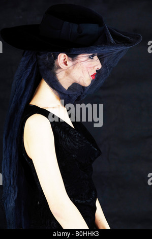 Young woman wearing black and a veil, widow - Stock Photo