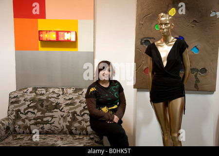 Eslabshop fashion boutique, interior view of mannequin and shop assistant in Zaragoza, Saragossa, Aragon, Spain - Stock Photo