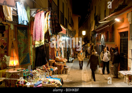 Teahouses, tourists and souvenir shops selling Moroccan handicrafts at night in the colourful Caldereria Nueva street, - Stock Photo