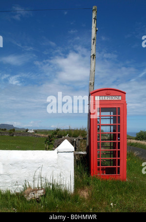 Old red phone booth, telephone box in Scotland, UK - Stock Photo