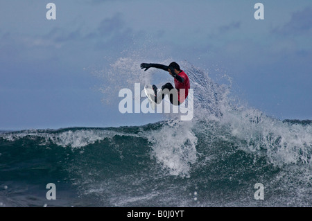 Surfer surfing performs in the air at Brimms Ness, during the O'Neill Highland Open 2008 - Stock Photo