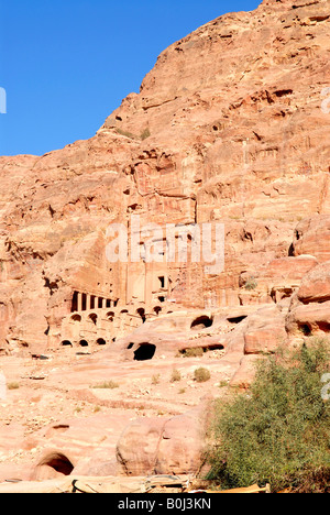 The Urn Tomb one of the Royal Tombs  carved into the face of Jabal Khubtha , of salmon pink and red sandstone in - Stock Photo