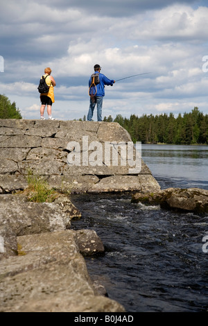 Fisherman and his wife at Karvion kanava Finland - Stock Photo