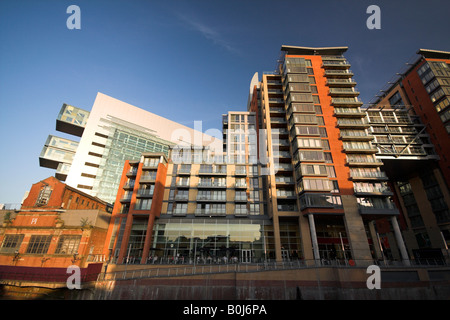 View of Civil Justice Centre, People's Museum, Leftbank apartments, Spinningfields, on the River Irwell, Manchester, - Stock Photo