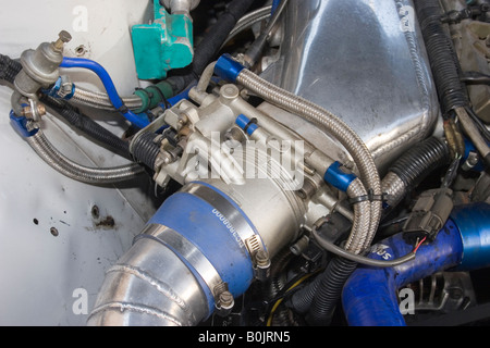throttle body on a modified Japanese sports car - Stock Photo