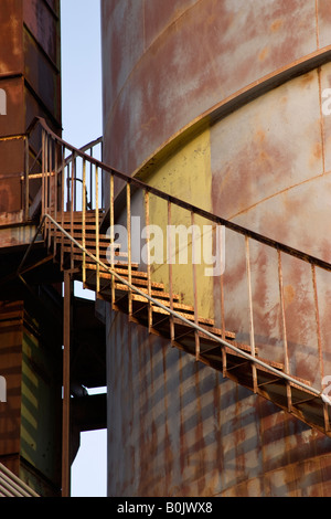Rusty 'spiral' metal stairs leading upward. - Stock Photo