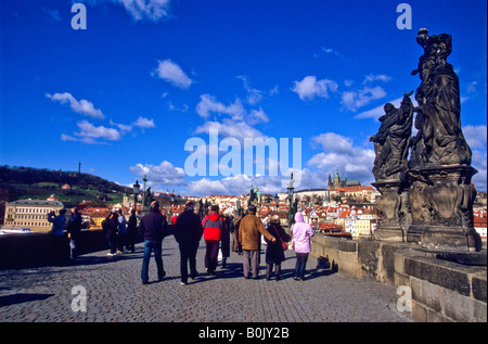Tourists on Charles Bridge, Prague, Czech Republic - Stock Photo
