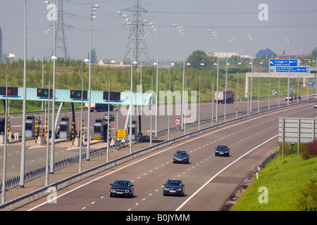 M6 TOLL MOTORWAY from above with toll booths and vehicles on carriageway West Midlands England UK - Stock Photo