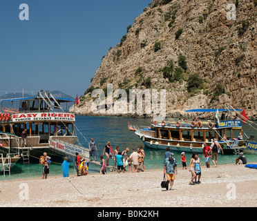 CHARTER BOATS AND DAY TRIPS  FROM OLU DENIZ MOORED IN BAY AT BUTTERFLY VALLEY  MUGLA TURKEY - Stock Photo