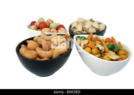Different tasty salted nuts in the bowls isolated on the white - Stock Photo
