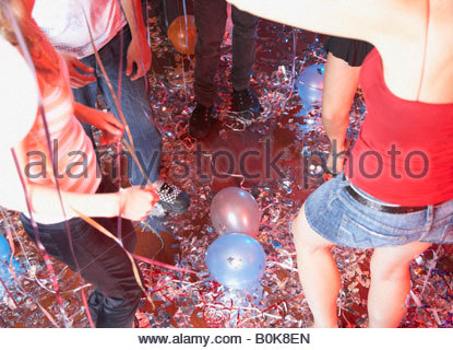 five people in a nightclub dancing - Stock Photo