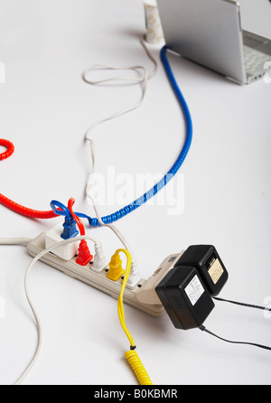 Computer Cables Attached To Extension Cord - Stock Photo