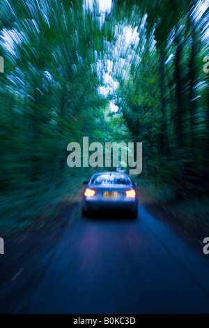 BMW car on country road at night Gloucestershire United Kingdom - Stock Photo