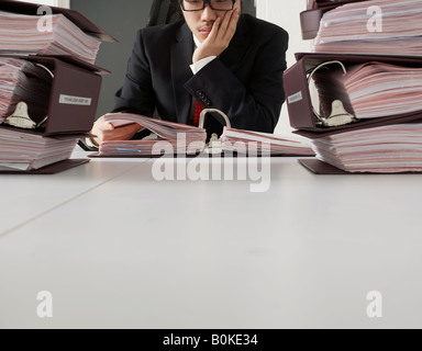 Office Worker Reading Documents - Stock Photo