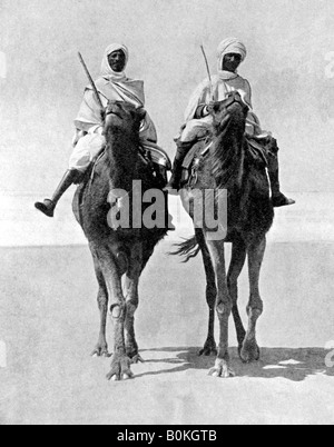 Two Arabs riding camels in the Sahara Desert, Africa, 1936. Artist: Fox Photos - Stock Photo