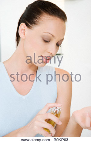 Woman trying on perfume in a store - Stock Photo