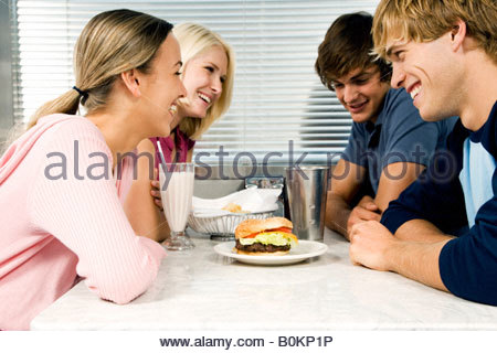 Friends hanging out in a diner - Stock Photo