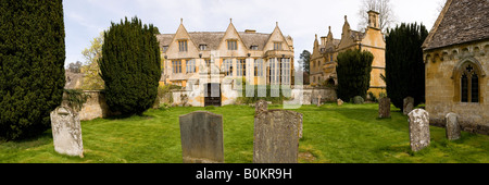 Stanway House and Gatehouse from the churchyard in the Cotswold village of Stanway, Gloucestershire - Stock Photo