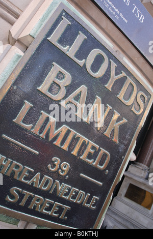 Lloyds Bank old brass company name plate on the branch in Threadneedle Street in The City of London - Stock Photo