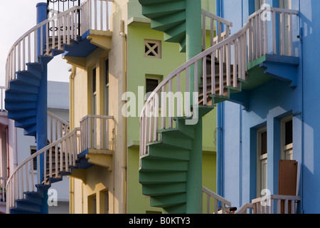 Spiral Staircases at the back of a Traditional Shophouses, Singapore - Stock Photo