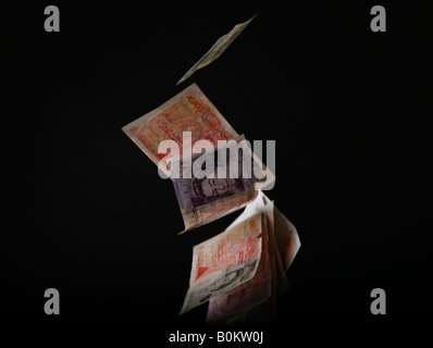 Floating cash, banking crisis, bank crisis, credit crunch - Stock Photo