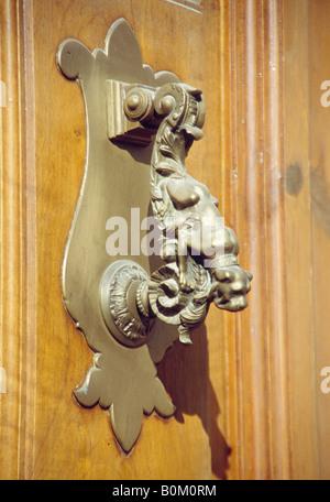 Knocker in wooden door. Ubeda. Jaen province. Andalusia. Spain. - Stock Photo