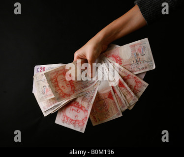 Cash in the hand, banking crisis, bank crisis, credit crunch - Stock Photo