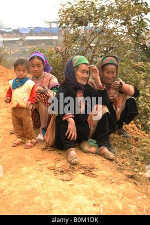 Vietnam Northwest Can Cau Flower Hmong minority hilltribe market women wearing traditional costume - Stock Photo