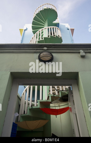 Spiral Staircase at the back of a Traditional Shophouse, Singapore - Stock Photo