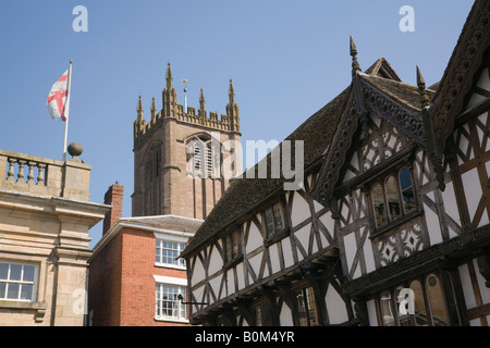 Ludlow Shropshire West Midlands England UK Black and white timber framed medieval building with church of St Laurence - Stock Photo