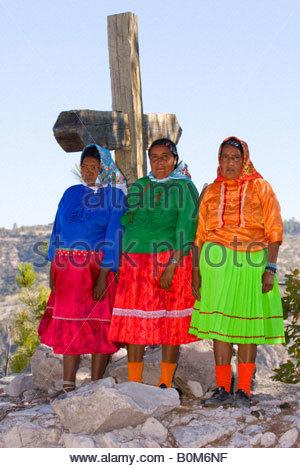 Tarahumara Indian women wearing colorful native costumes Copper Canyon near San Rafael Mexico - Stock Photo