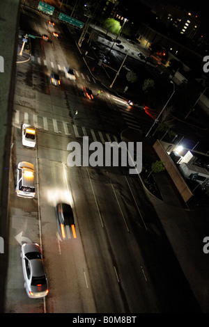 Police officers direct traffic in an intersection during a power outage, from high above. - Stock Photo