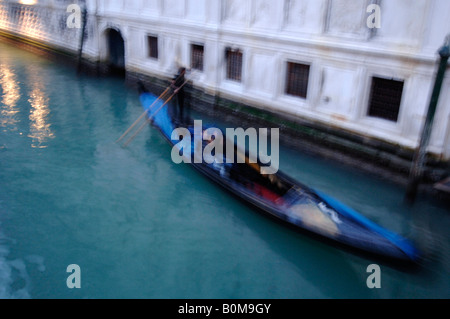 Gondola on a canal in Venice - Stock Photo