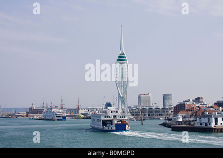 Isle of Wight ferry approaching the Emirates Spinnaker Tower, Portsmouth Harbour, Hampshire, England, UK - Stock Photo