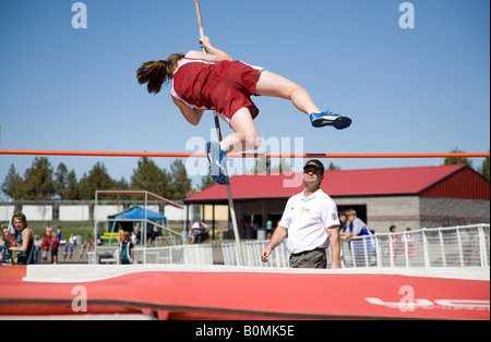 A middle school junior high school district track meet in the spring track season This is a girl s pole vault - Stock Photo