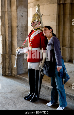Tourist With Soldier From The Queens Royal Houseguards Lifeguards Cavalry With Indian Woman Whitehall London UK - Stock Photo
