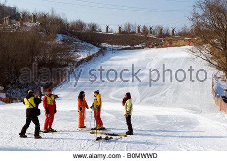 a ski instructor and student at Yabuli ski resort Heilongjiang Province Northeast China - Stock Photo