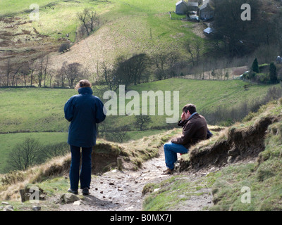 'Couple' look as though arguing, or tired out, on Mam Tor footpath. Peak District National Park. Derbyshire - Stock Photo