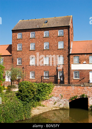 Converted Victorian mill building on the River Rase at Market Rasen in Lincolnshire, UK - Stock Photo