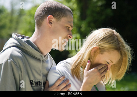 young man comforting girlfriend - Stock Photo
