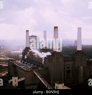 aerial photograph of the smoking chimneys of Battersea Power Station - Stock Photo