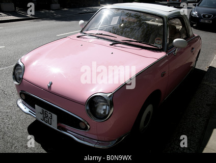 Barbie doll pink Nissan Figaro retro style car in London - Stock Photo