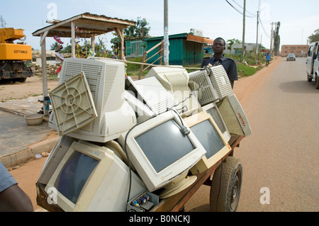 Scrap sellers pulling a cart with with computer trash, Nsawam Ghana - Stock Photo