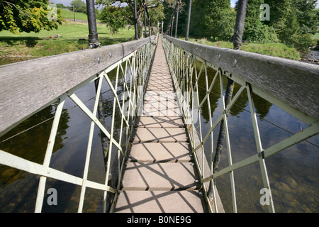 Suspension footbridge over the River Wharfe near Hebden, Yorkshire Dales. - Stock Photo