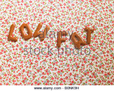 Word LOW FAT on a tablecloth made from alphabet biscuits - Stock Photo