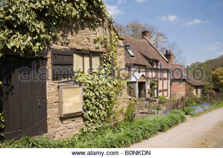 Quaint old English cottages and outbuilding on country lane in rural village of Hope Bowdler Shropshire West Midlands - Stock Photo