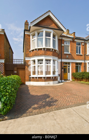 A typical 3 bed semi detached Victorian/Edwardian house in suburbia with a paved drive. - Stock Photo